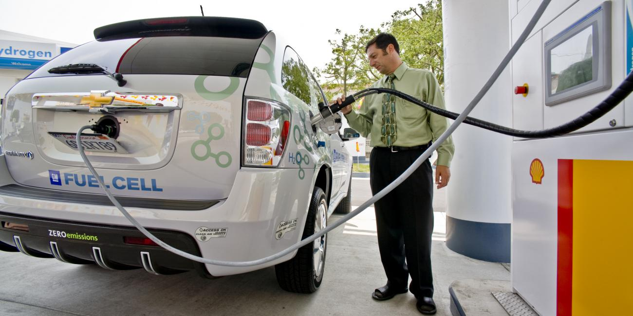Man refueling a hydrogen fuel cell car
