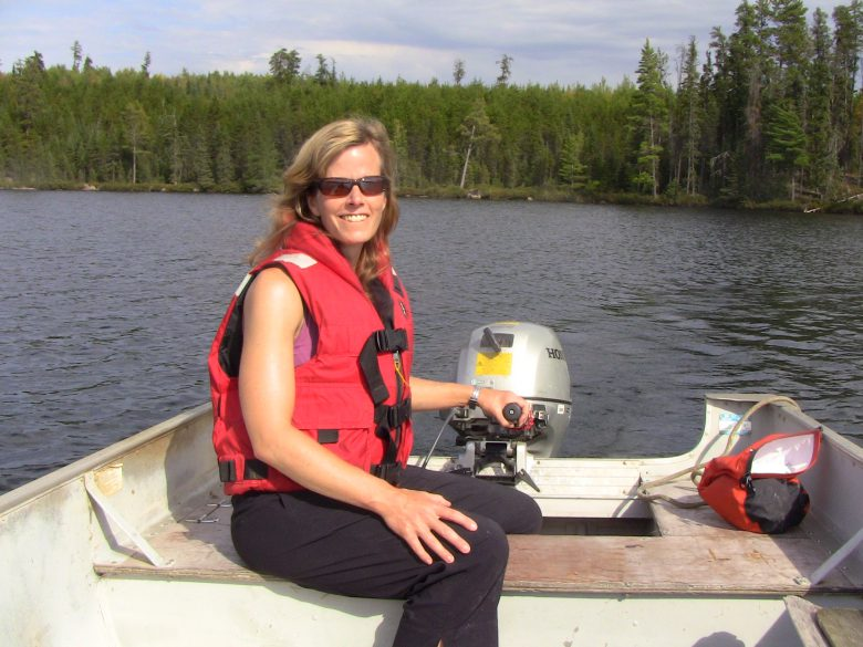 Karen Kidd out on a boat on a lake at IISD Experimental Lakes Area