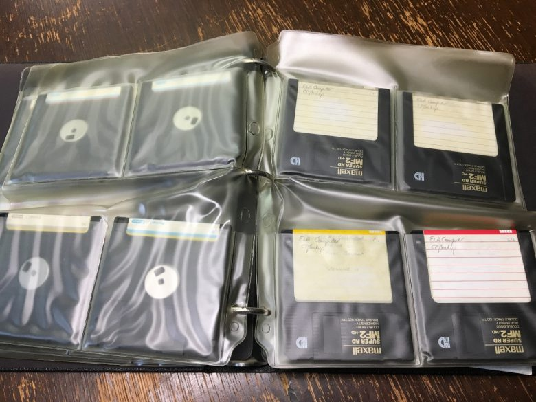 Various coloured floppy discs in a plastic folder