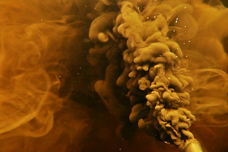 Amber plumes in an underwater shot of a lake