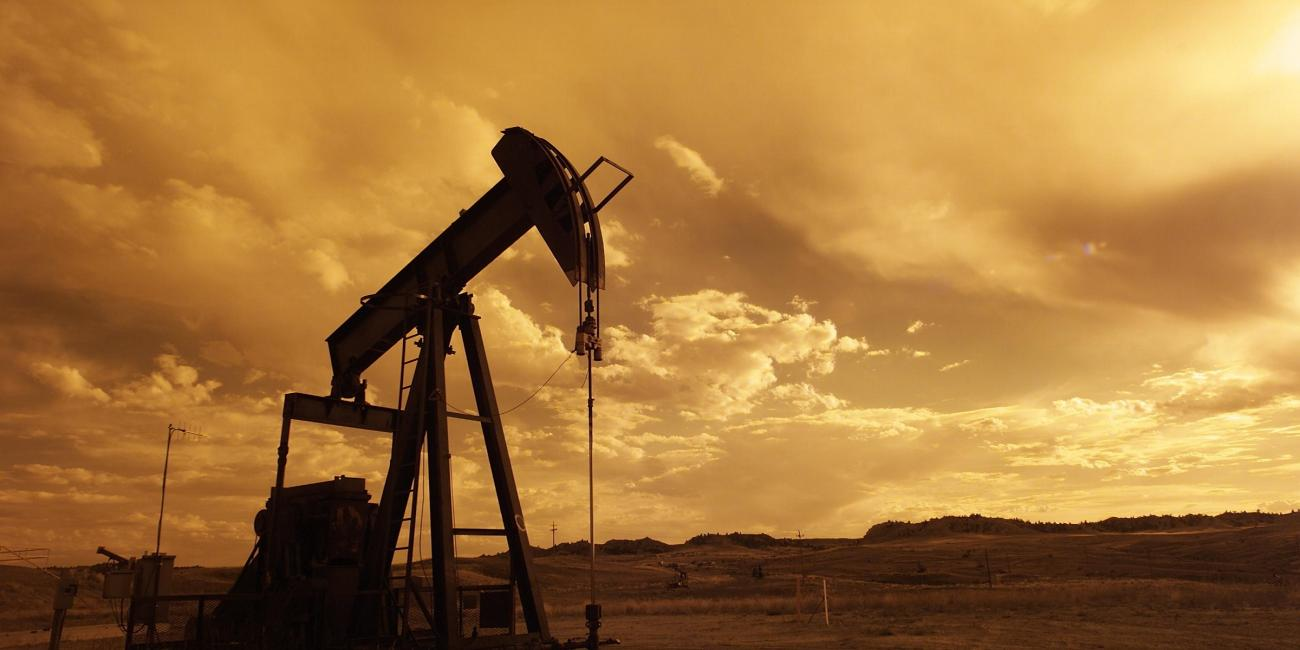 An outdoor shot of an oil-rig, set in a sepia tone.