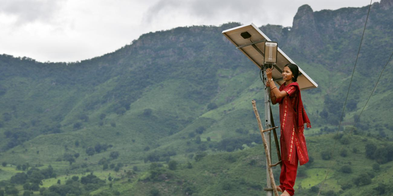 woman changing solar panel
