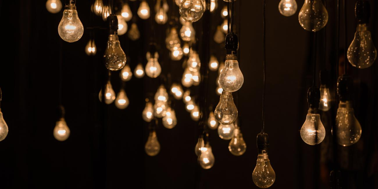 lightbulbs hanging in dark room