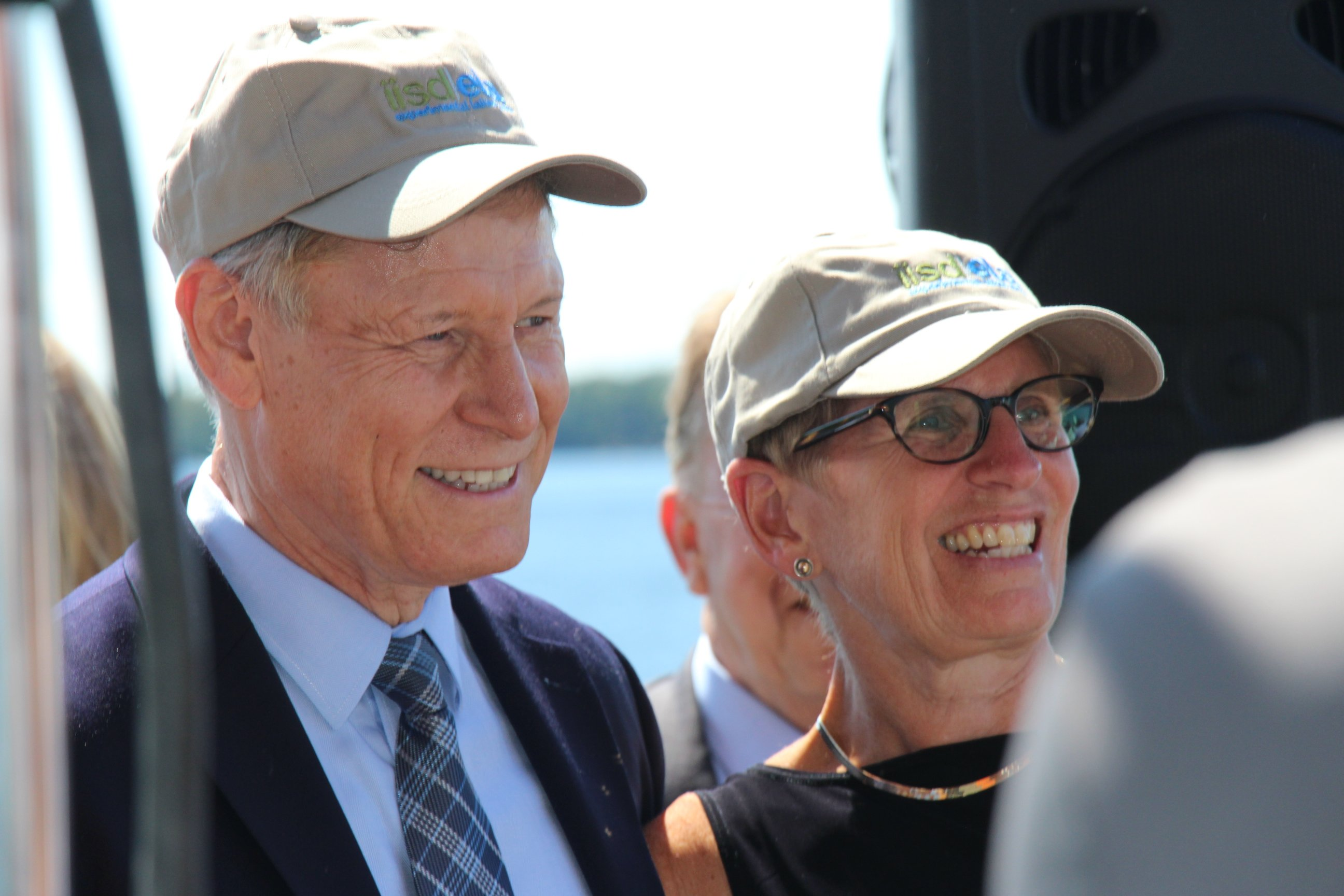 Hon. Terry Duguid and Premier Wynne pose with IISD-ELA branded caps