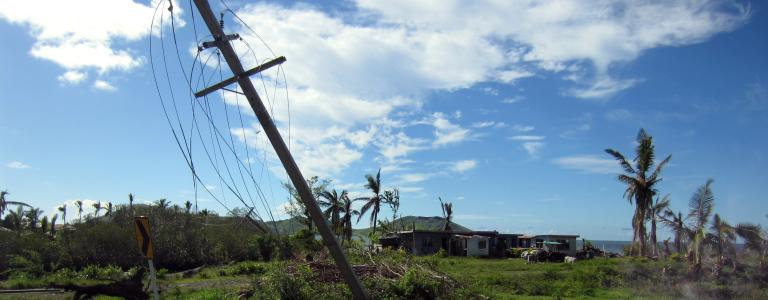 Downed electrical poles after a storm in Fiji