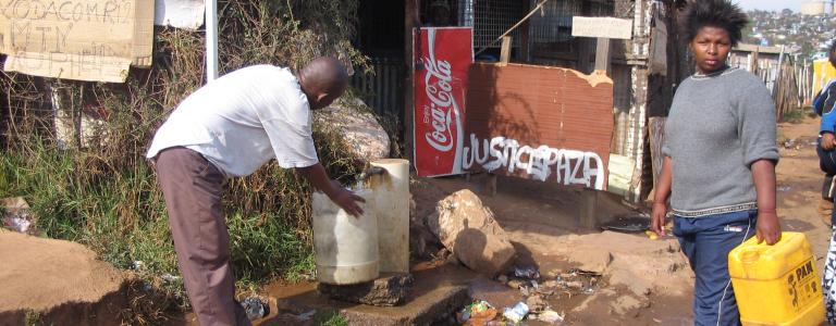 Communal_tap_(standpost)_for_drinking_water_in_Soweto,_Johannesburg,_South_Africa_(2941729790).jpg