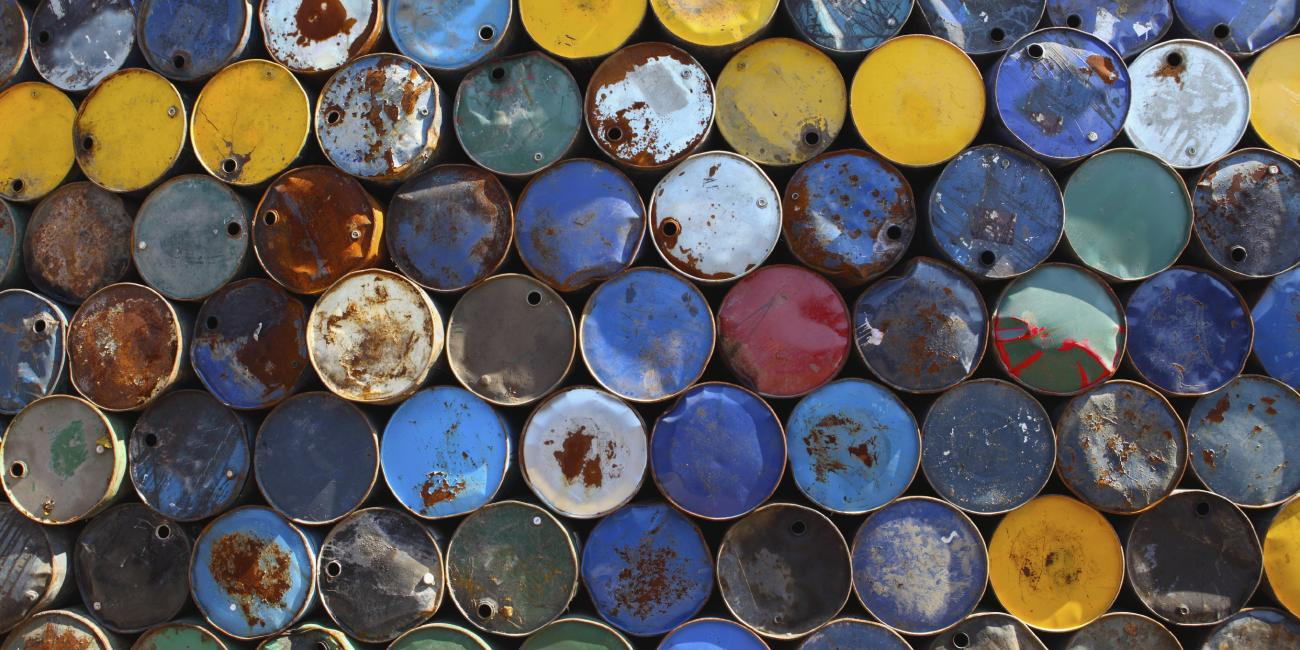 Colourful gas tank stacked on their side.