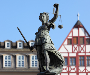 300 year old statue of Lady Justice overseeing the Well of Justice  at Frankfurts Roemer Square / Germany