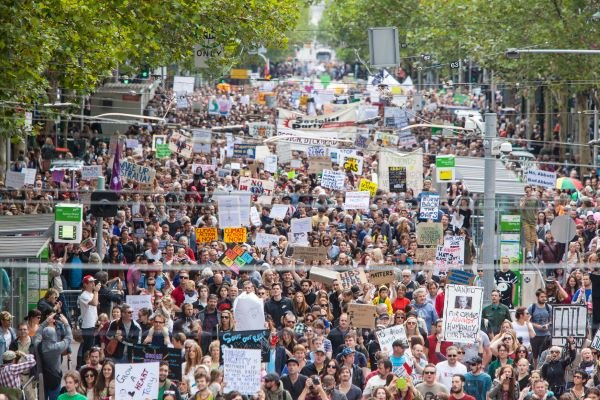 Thousands of peeople marching for climate justice in Australia, bird's eye view