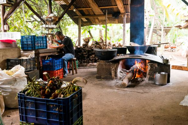A roadside market in Costa Rica with an outdoor fireplace
