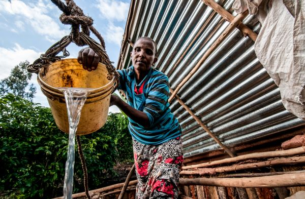 A woman farmer in Ethiopia harvests rainwater in her adaptation to the effects of climate change
