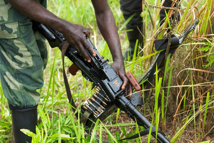 In North Kivu, DRC, a rebel soldier checks his weapon before patrols.