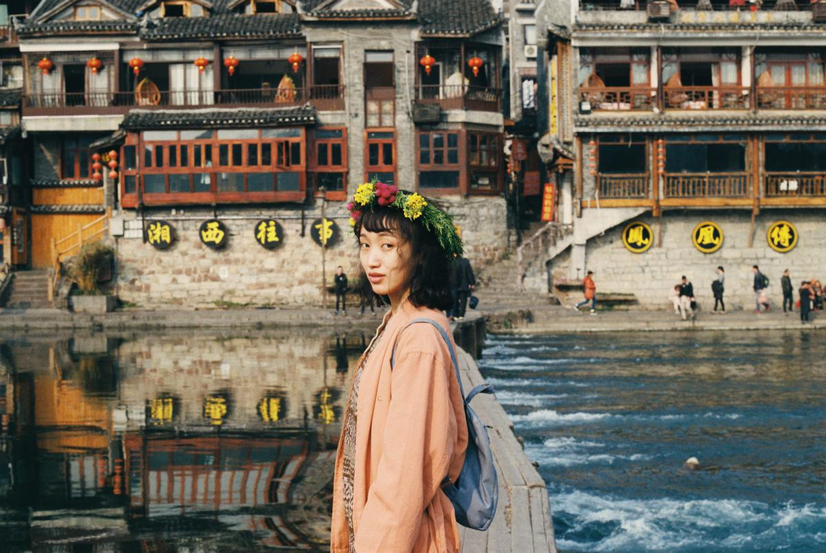 Chinese woman in front of river