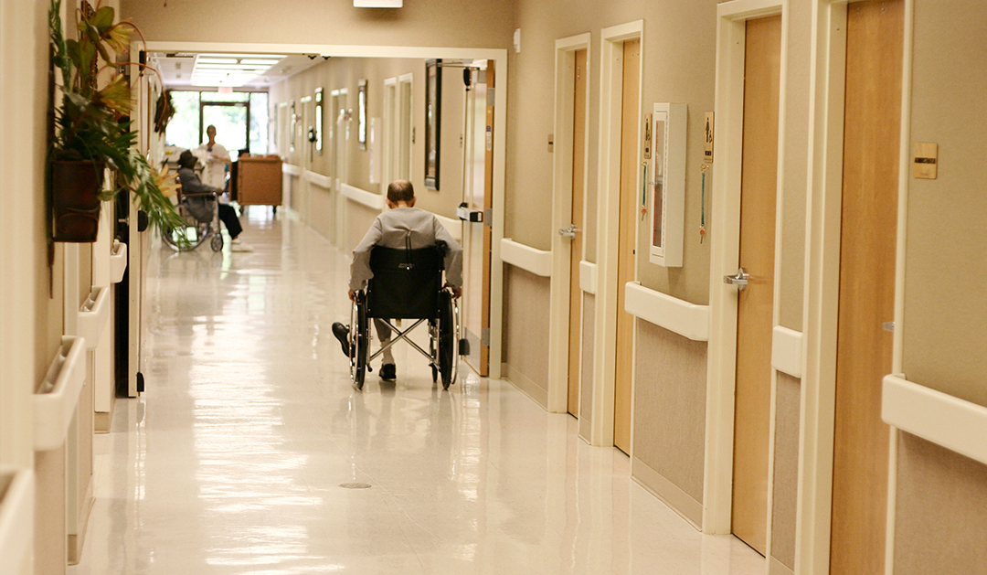 Man in wheelchair in hallway